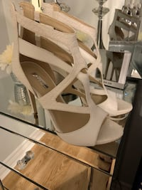 Brand new white/offwhite Guess stilettos.  Never been worn. Size 7.5