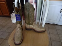 pair of brown leather cowboy boots Butler
