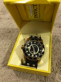 round black Invicta chronograph watch with black strap Airdrie, T4B 3R9