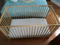 baby's brown wooden crib Toronto, M4L 2Z9