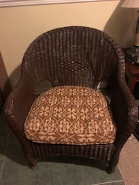 Brown wicker chair with cushion, EUC as it was only used for decoration. No sagging in the wicker.