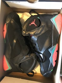 pair of black Air Jordan 7's Washington, 20024