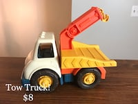 Yellow, orange, white, and blue plastic tow truck toy Columbia, 21045