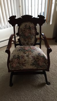 Antique rocker chair.   Brown wooden framed. Reupholstered     Needs some work on arms Forked River, 08731