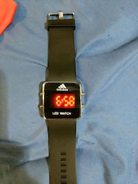 black smartwatch with brown strap Port Coquitlam, V3C 1Z8