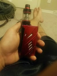 red and black variable box mod with tank atomizer
