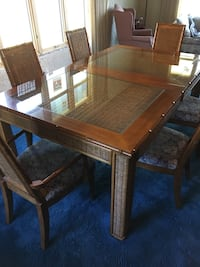Rectangular brown wooden framed glass top dining table set and matching hutch