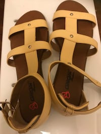 Size 10 Babe Pair of brown leather sandals Houston, 77034