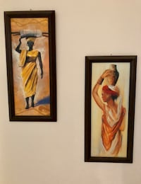 Two brown wooden framed painting of woman Kelowna, V1Y 3Z5