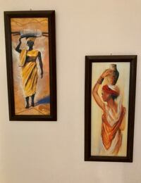 Two brown wooden framed painting of woman