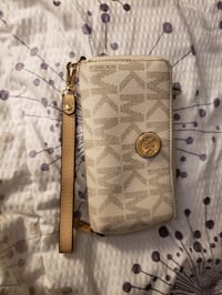 Michael kors jet setter wallet has pocket for iPhone.
