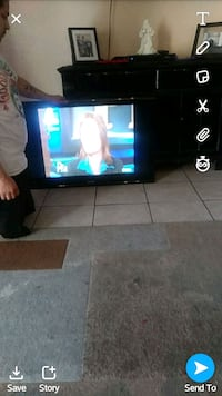 black flat screen TV and brown wooden TV stand Bakersfield, 93307