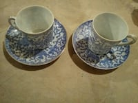 two blue-and-white floral ceramic mugs with saucer 719 km