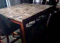 Marble top dining table with six matching leather chairs  Surrey, V3T 2E5