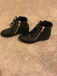 Black boots with gold zippers