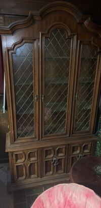 brown wooden framed glass display cabinet Mt Airy, 21771