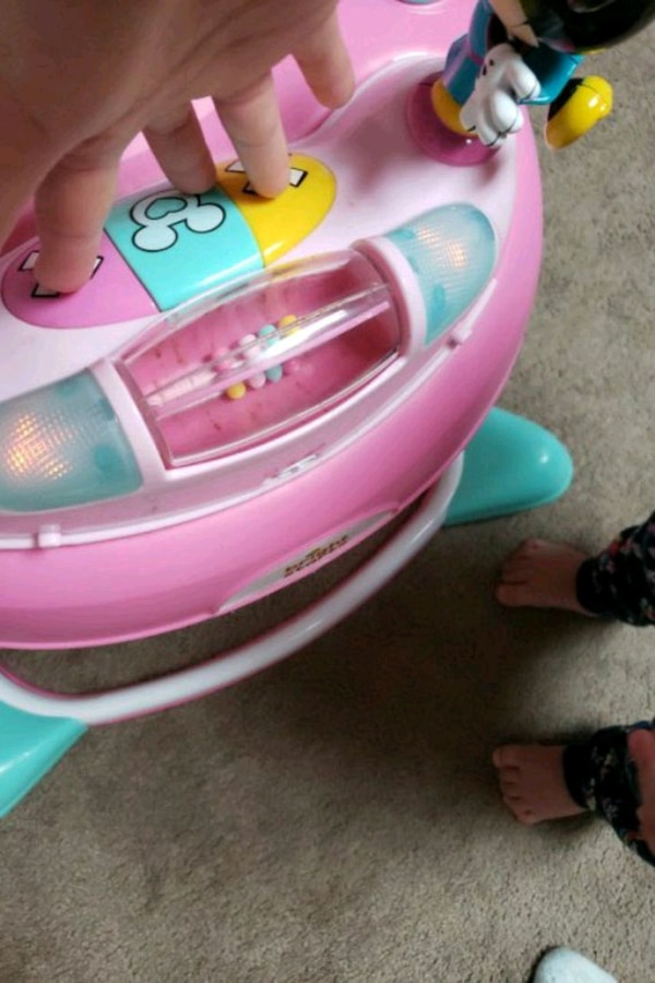 pink and teal plastic toy