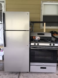 GE Grey and black stove and refrigerator  Ypsilanti