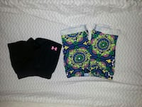 two black and green-pink-and-blue short shorts