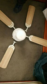 brown and white 4-blade ceiling fan