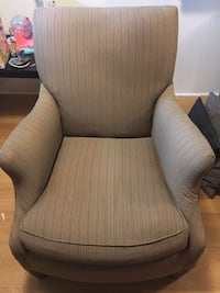 Brown and white striped arm chair
