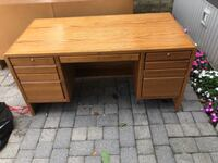 brown wooden single pedestal desk null