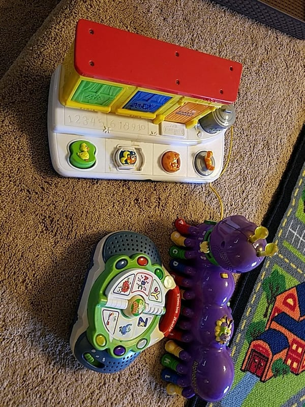three toddler's multicolored activity musical toys 689fa3b2-ab46-443c-93cc-9b35172a79d6