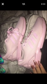 Pair of pink adidas running shoes