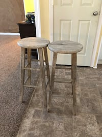 Two round gray wooden stools Ludowici, 31316