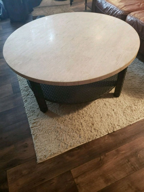 round tan patio or coffee table