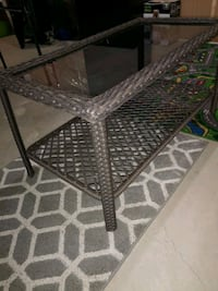 (NEW).Glass top wicker coffee table $65.00