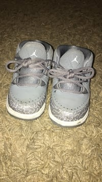 toddler's pair of gray-and-white Air Jordan shoes
