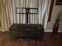 TV stand hold up to 65 inches  43 km
