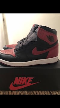 unpaired black and red Air Jordan 1 shoe with box New York, 10019