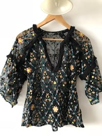 black and brown floral long-sleeved shirt Montréal, H2M 1R6