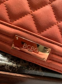 New hand bag with minor scratches on side