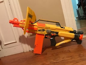 yellow and red Nerf blaster