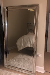 Mirror- barely used. Hooks on the back to hang it.