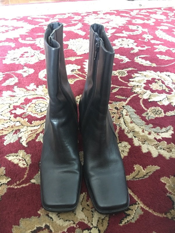 pair of black leather zippered boots