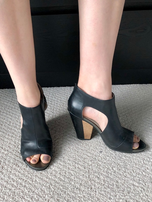 Black cut out heel pumps