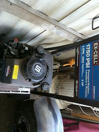 black and blue Ex-Cell pressure washer
