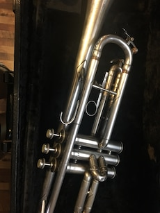 Roth trumpet.  Silver functions and works properly.  Comes with hard case that is beat up