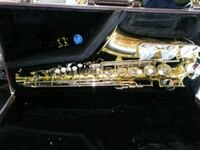 gold saxophone with black bag Seaford, 19973