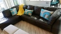 black leather sectional sofa with throw pillows Fort Lauderdale, 33324