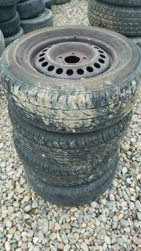 four black auto wheel with tires Grand Junction, 81501
