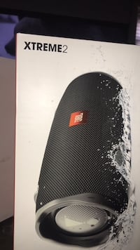 black and white JBL portable speaker