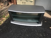 white wooden framed glass top TV stand Dale City