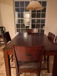 dark wood  dining table  chairs with metal insert and leather chairs Virginia Beach, 23456