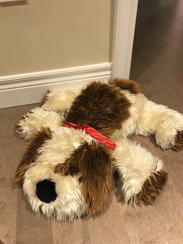 white and brown dog plush toy