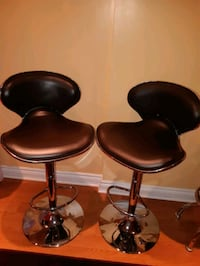 Pair of adjustable height swivel bar stools brown Vaughan, L4H 2M7